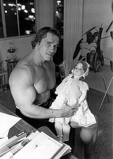 Arnold Schwarzenegger with a doll